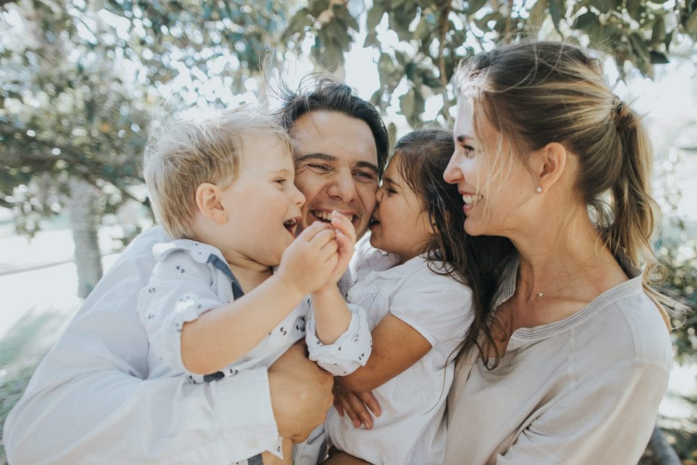 laughing family in brighton park - family photographer captures natural smiles and candid moments