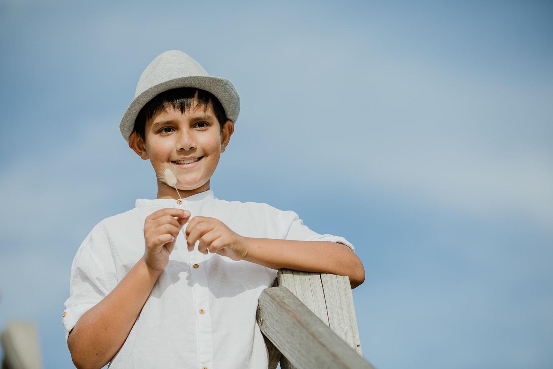 child in sun - wearing hat - family photos in Mornington