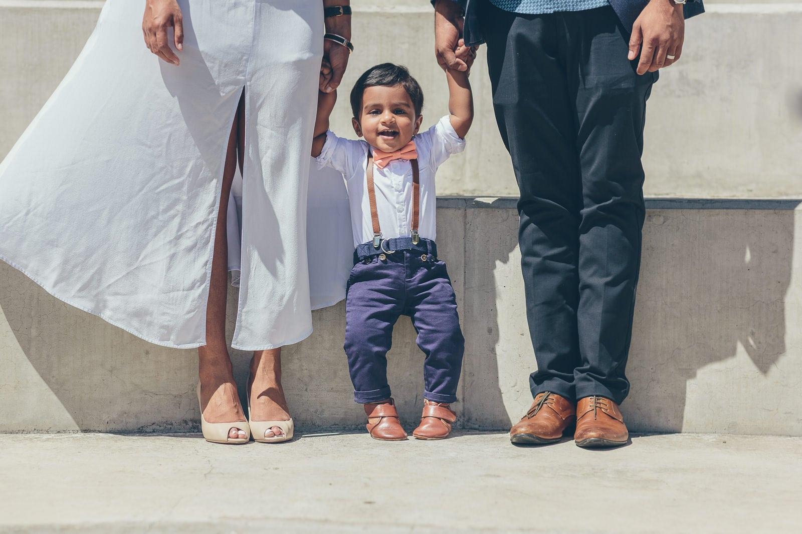 Kids and Baby shoots in Vermont - Child standing between parents